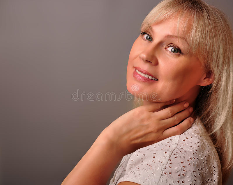 Portrait of a cute mature woman smiling stock images