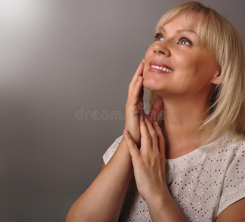 Portrait of a cute mature woman smiling royalty free stock image