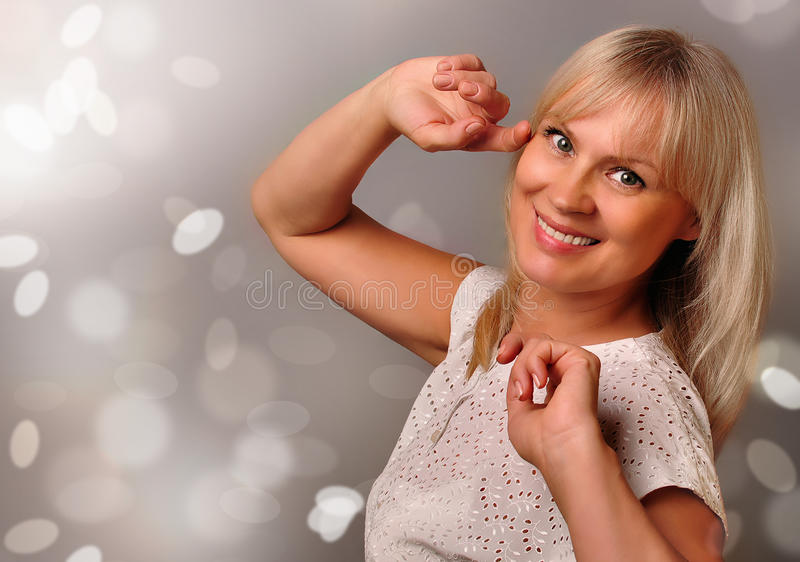 Portrait of a cute mature woman smiling stock photo