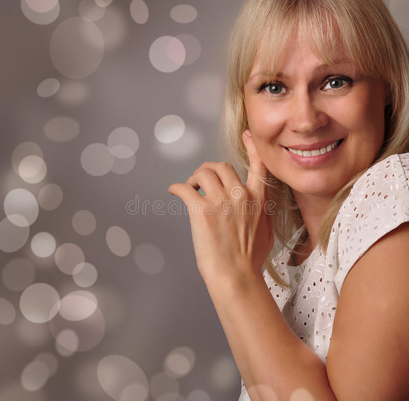 portrait of a cute mature woman smiling stock photo - image of life