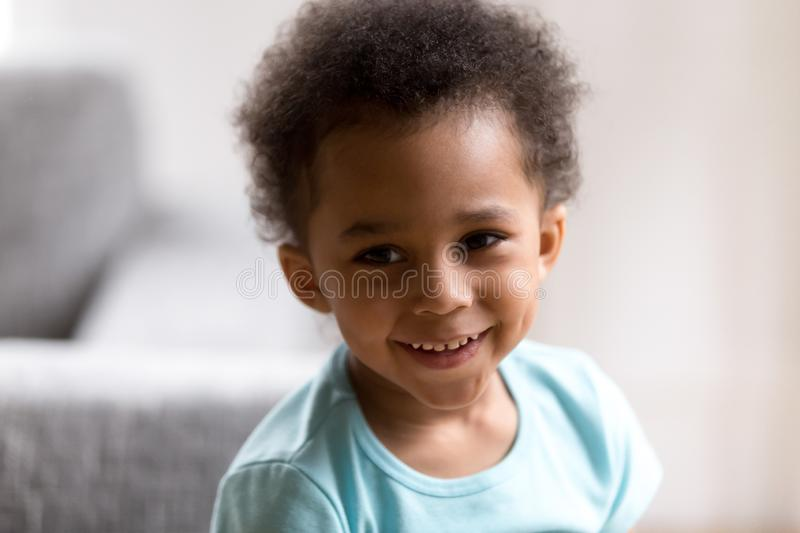 Portrait of cute mixed race toddler boy smiling royalty free stock images