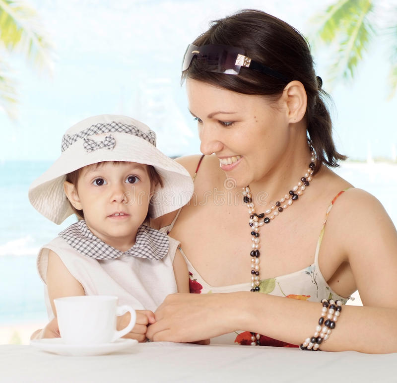 Portrait of a cute mom with baby stock photography