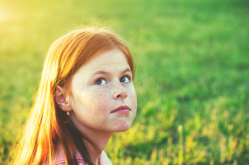 Portrait of cute redhead girl with freckles stock images