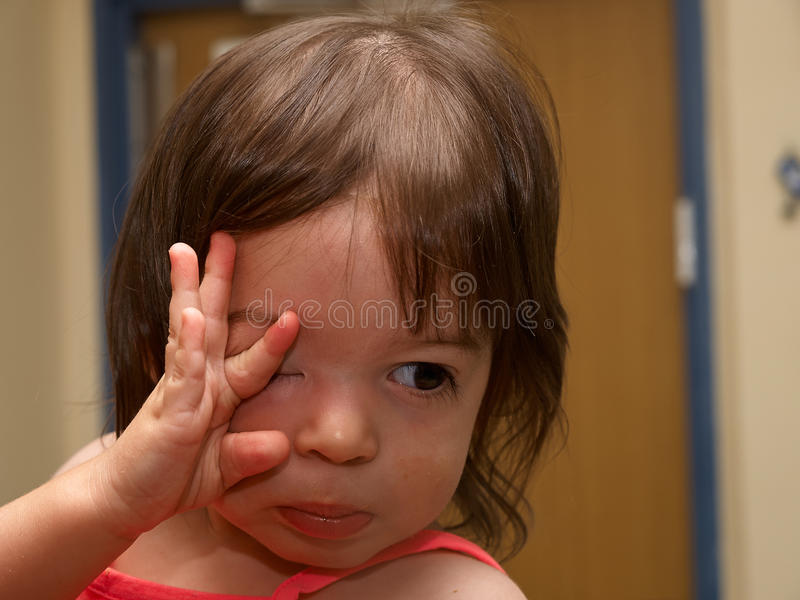 Portrait of cute sad crying toddler girl stock photography