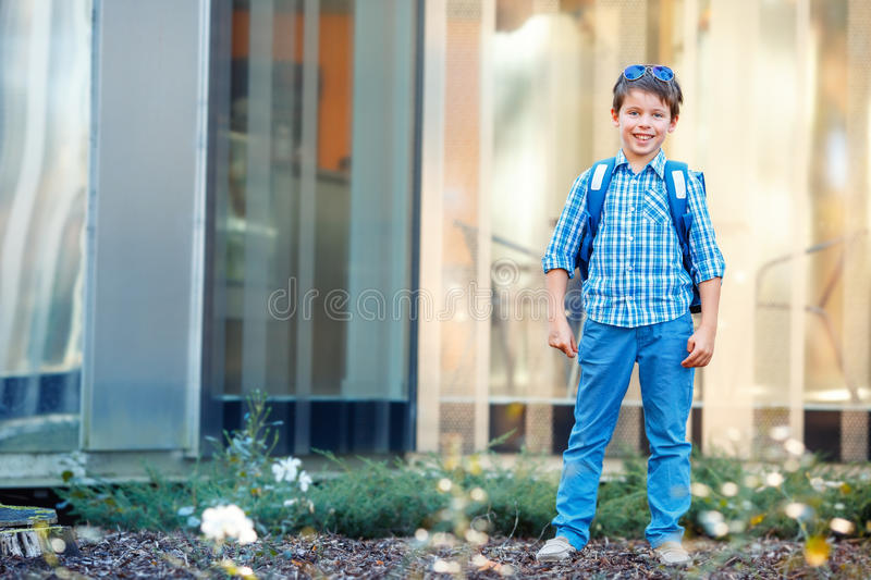 Portrait of cute school boy with backpack. Outdoors stock image