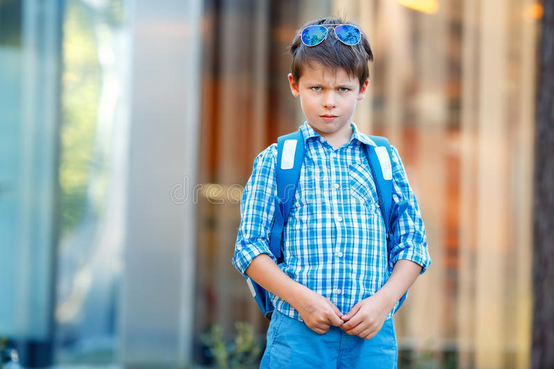 Portrait of cute school boy with backpack. Outdoors royalty free stock image