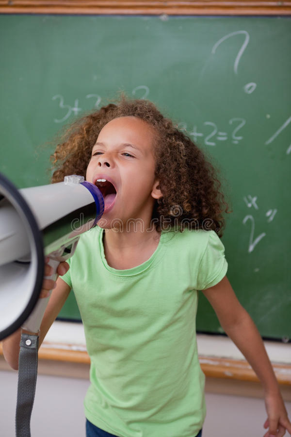 Download Portrait Of A Cute Schoolgirl Screaming Through A Megaphone Stock Image - Image: 22692401