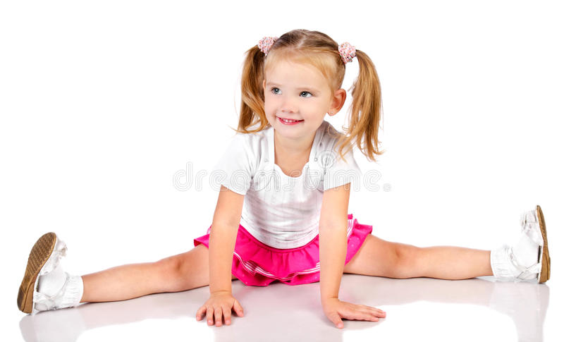 Portrait of cute sitting smiling little girl stock photos