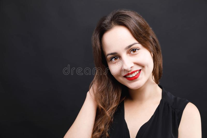 Portrait Of Cute Woman In Black Dress royalty free stock photos