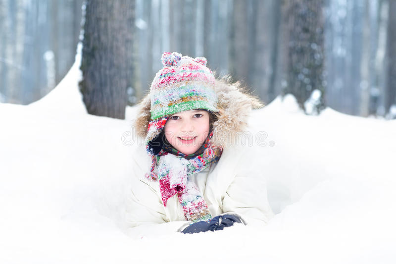 Portrait of a cute smiling child digging in snow. Portrait of a cute smiling child digging in the snow park royalty free stock image