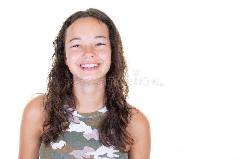 Portrait of cute smiling girl in army camouflage T-shirt isolated on white background. A Portrait of cute smiling girl in army camouflage T-shirt isolated on royalty free stock photo