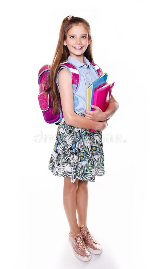 Portrait of cute smiling happy little school girl child teenager with school bag backpack and books isolated. On a white background education concept stock image