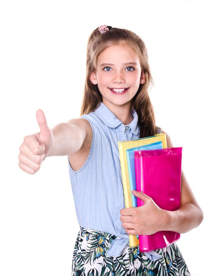 Portrait of cute smiling happy little school girl child teenager with finger up and books stock image