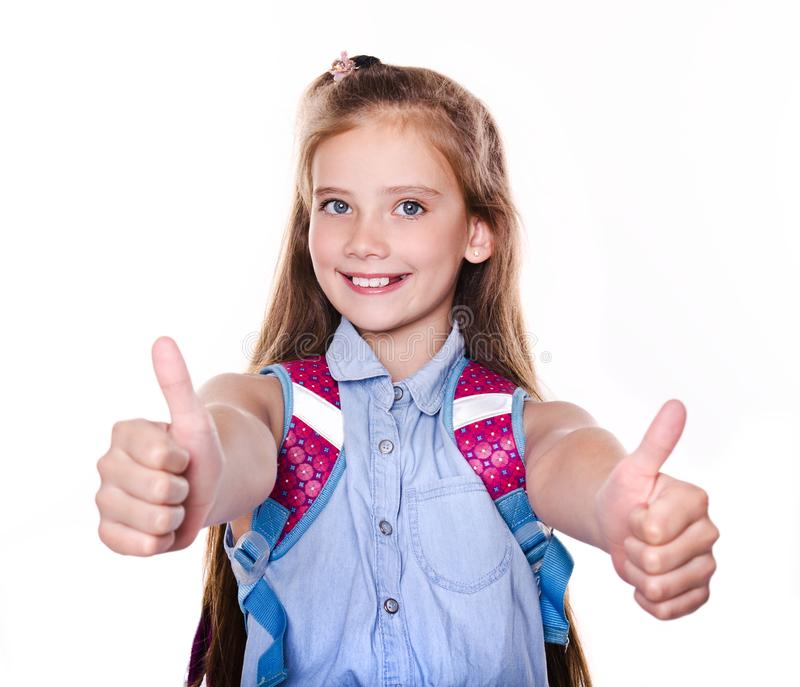 Portrait of cute smiling happy little school girl child teenager with two fingers up and backpack royalty free stock image