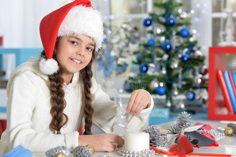 Portrait of cute smiling little girl preparing for Christmas royalty free stock images