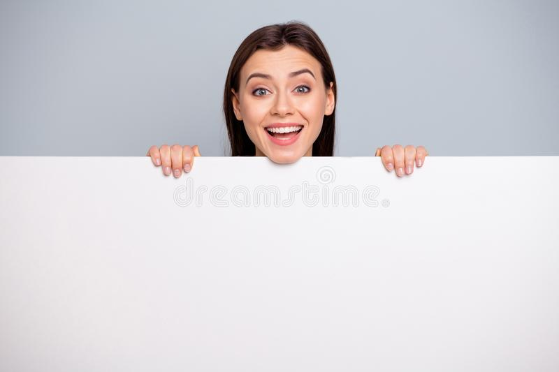 Portrait of cute sweet teen teenager promoter have advertisements hold hands laugh laughter have free time isolated grey. Portrait of cute sweet teen teenager stock photo