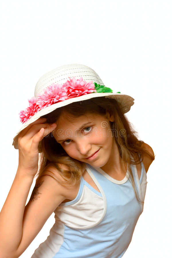 Portrait of cute teen girl. In white hat stock image