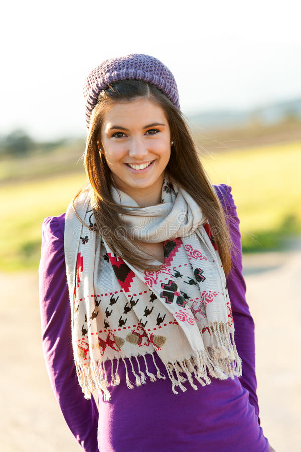 Portrait Of Cute Teen Girl With Scarf And Beanie. Stock