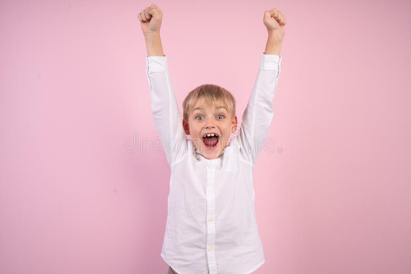 Portrait of cute trendy stylish kid astonished impressed aims contest lottery fortune, scream omg, wow, unbelievable unexpected royalty free stock image