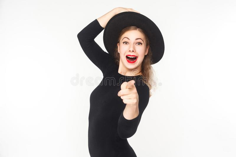 Portrait of cute woman, pointing fingers at camera, open mouth. Studio shot, isolated on white background royalty free stock photo