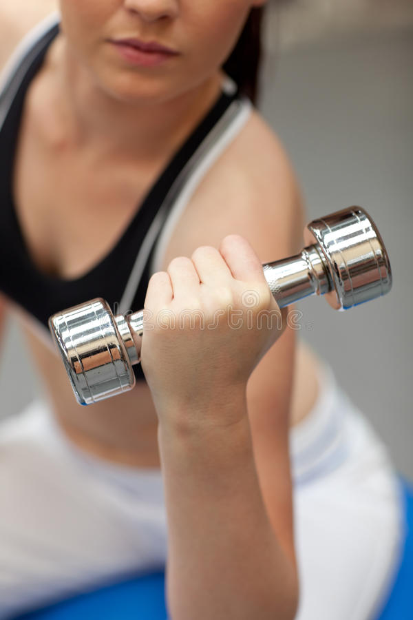 Portrait of a cute woman working out with dumbbell stock photos
