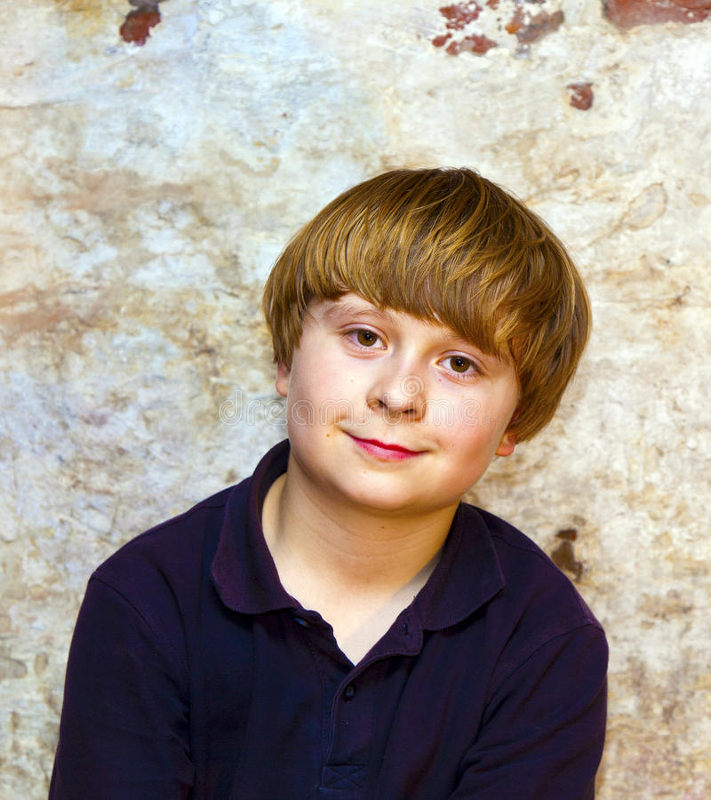 Portrait of a cute young boy. With old brick background royalty free stock photos