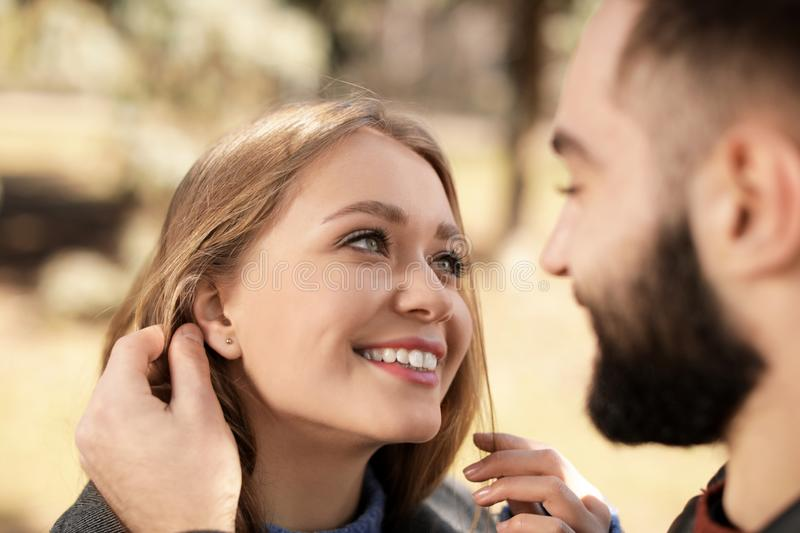 Portrait of cute young couple outdoors. Closeup stock image