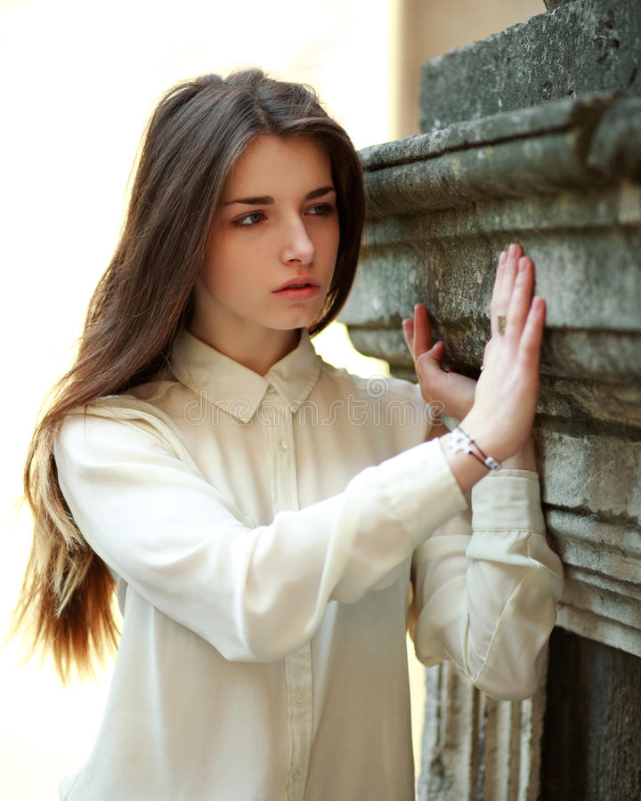 Portrait of a cute young girl in sorrow stock image