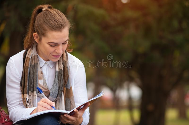 Cute young female student stock photography