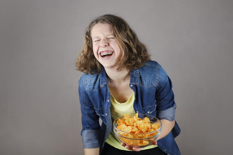 Portrait of a cute young laughing girl  with braces stock photos