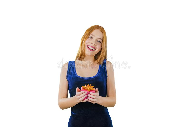 Portrait of a cute young red-haired girl in an evening dress with a box in her hands emotionally joyfully touches her royalty free stock photos