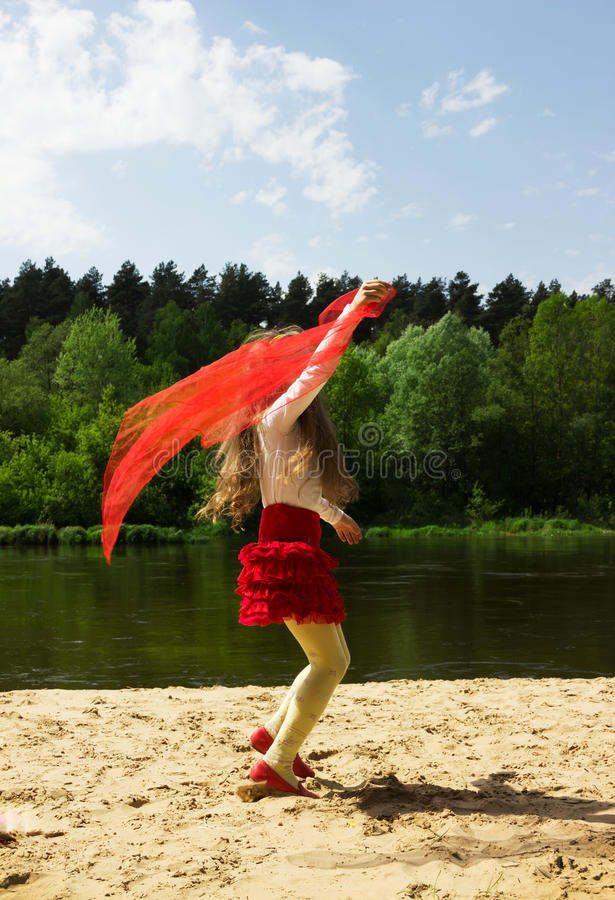 portrait of cutly cute girl with red Scarf at the stock image
