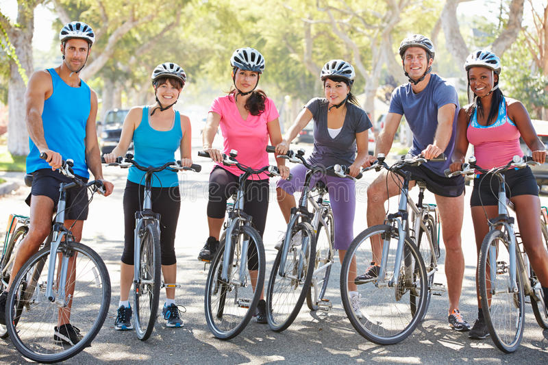 Portrait Of Cycling Club On Suburban Street royalty free stock images