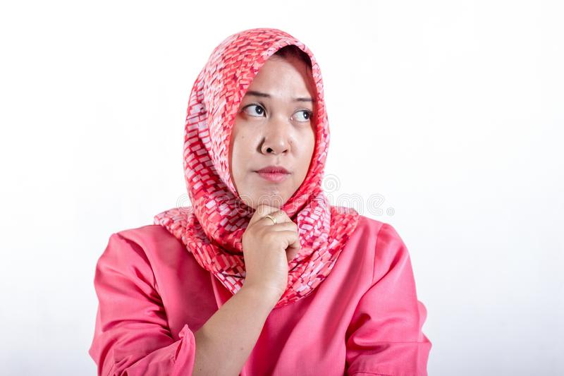 Portrait of cynical Asian muslim woman with suspicious expression stock photo