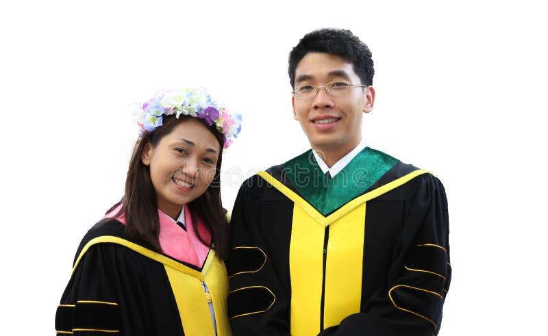 Portrait d'étudiant de graduation deux heureux photos stock