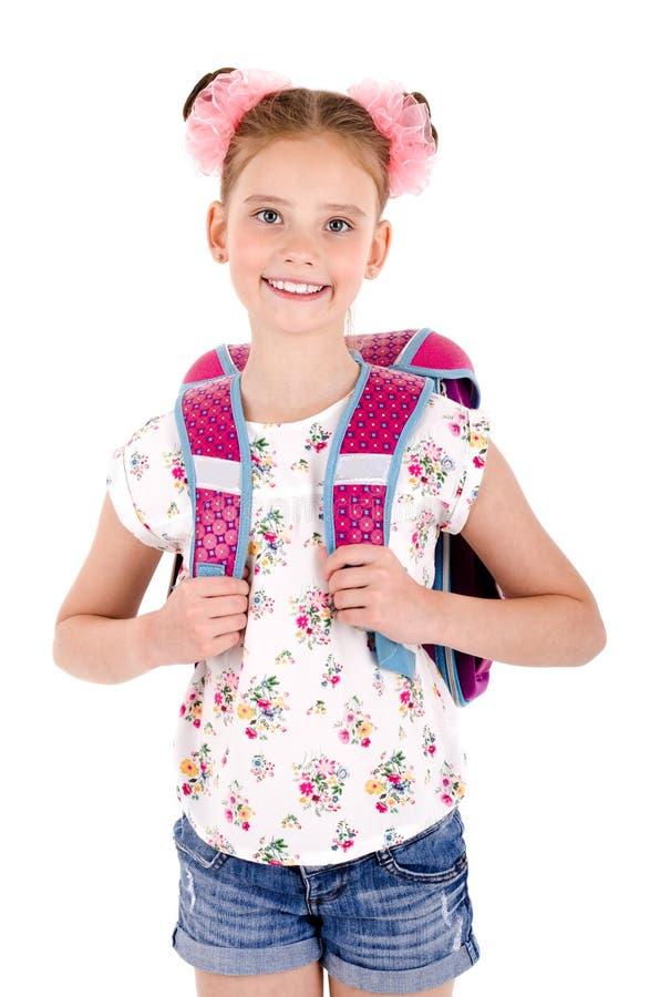 Portrait d'enfant heureux de sourire de fille d'école avec le sac à dos de sac d'école d'isolement sur un fond blanc photos libres de droits