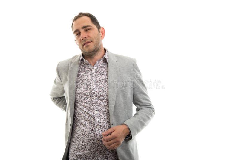 Portrait d'homme d'affaires montrant le geste de douleurs de dos photo stock