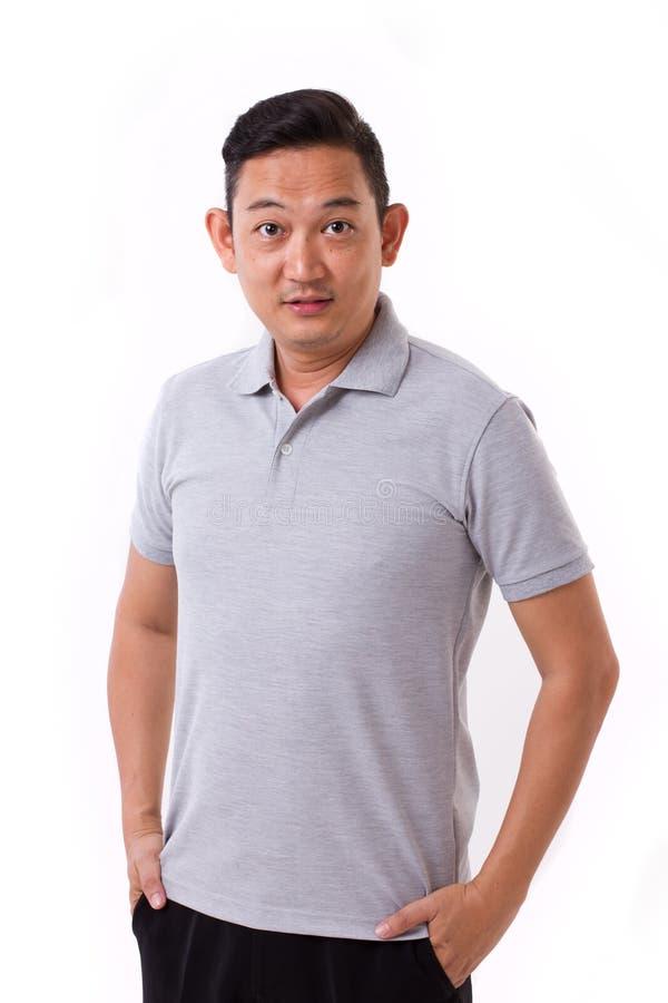 Portrait d'homme asiatique heureux et satisfait photographie stock