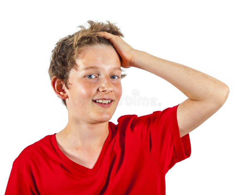 Portrait d'un garçon de l'adolescence de sourire dans le studio photos stock