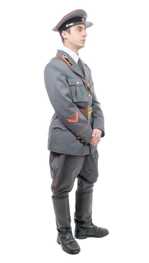 Portrait d'un jeune dirigeant de l'armée soviétique, d'isolement sur le petit morceau photos stock