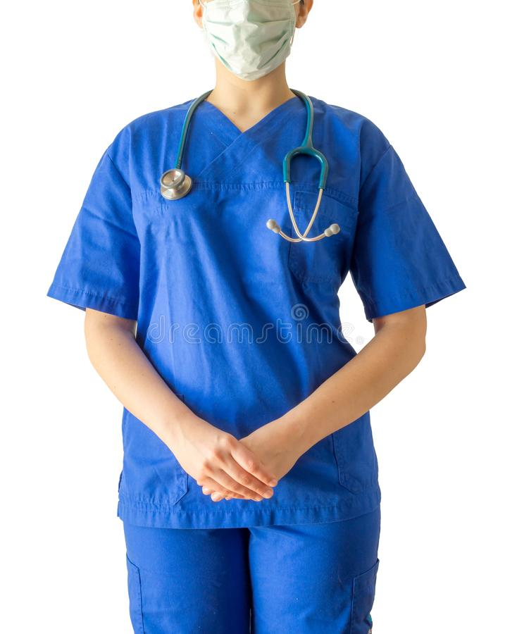 Portrait d'un jeune docteur inconnu dans la prise uniforme médicale bleue photo libre de droits