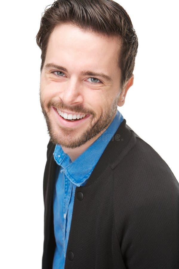 Portrait d'un jeune homme riant sur le fond blanc d'isolement images stock