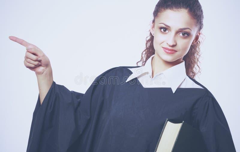 Portrait d'un jeune juge féminin, d'isolement sur le fond blanc photographie stock libre de droits