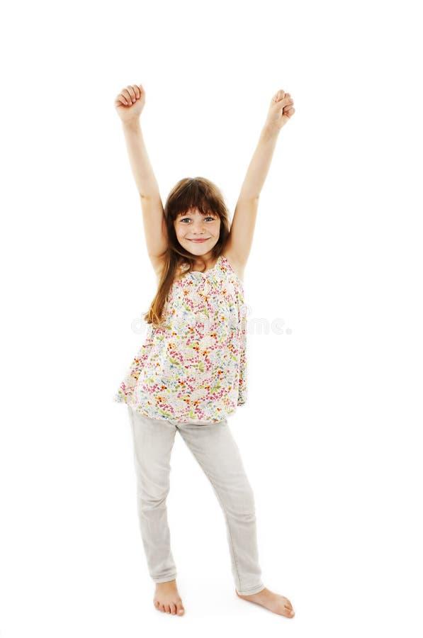 Portrait d'une belle et sûre fille avec des bras sur l'air image stock