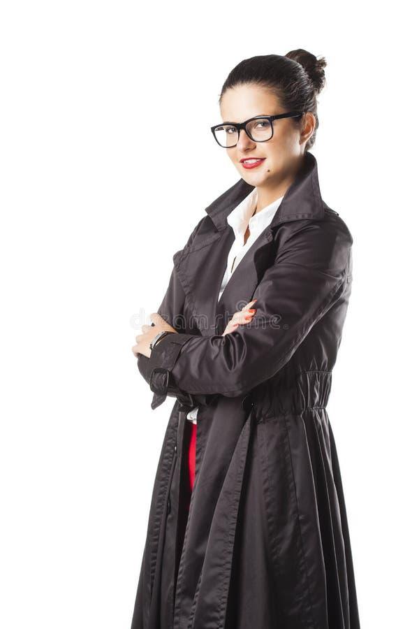 Portrait d'une belle fille d'affaires avec des verres images stock