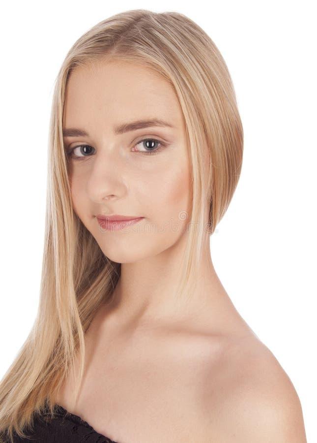 Portrait d'une belle fille blonde d'isolement sur le fond blanc images libres de droits