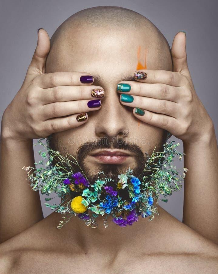 Portrait d'une femme et d'un homme avec le maquillage coloré créatif image stock