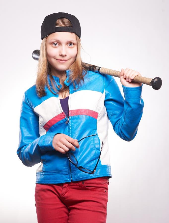 Portrait d'une fille de l'adolescence avec la batte photographie stock libre de droits
