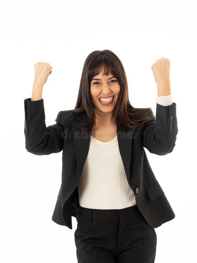 Portrait d'une jeune belle femme d'affaires avec des bras vers le haut de la célébration D'isolement sur le fond blanc photographie stock libre de droits