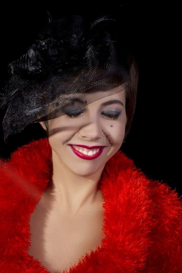 Portrait d'une jeune femme dans le rétro style photos stock